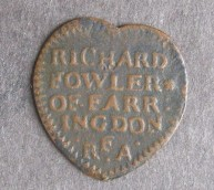 Can you guess what this is and how it was used? Answer: Copper alloy trading token in the shape of a heart from 1668 – tokens were created by tradesmen during and after the Civil War due to the lack of official small coinage being created by the national mints or royal licences. They could be used in exchange for goods. This example, as the reverse states, was equivalent to a halfpenny and was produced by a Richard Fowler of Farringdon. The symbol on below halfpenny is that of 'The Barber-Surgeon Arms'.