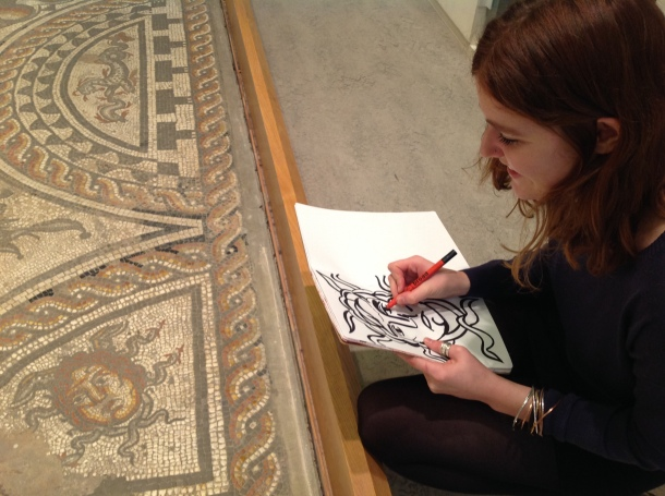 Tilly finding inspiration for the children's corner on the 2nd century Hunting Dogs mosaic